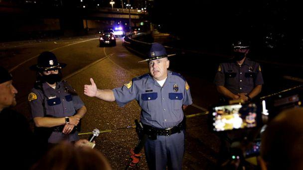 PHOTO: Washington State Patrol Capt. Ron Mead briefs media near the scene where two people in a group of protesters were struck by a car on Interstate 5 while the highway was closed to traffic due to the protest in Seattle, July 4, 2020. (Jason Redmond/Reuters)