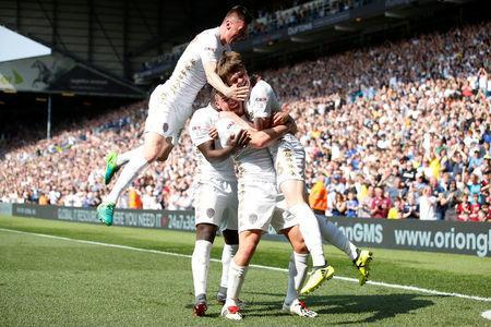 Soccer Football - Championship - Leeds United v Barnsley - Elland Road, Leeds, Britain - April 21, 2018 Leeds United's Tom Pearce celebrates scoring their first goal with team mates Action Images/Craig Brough
