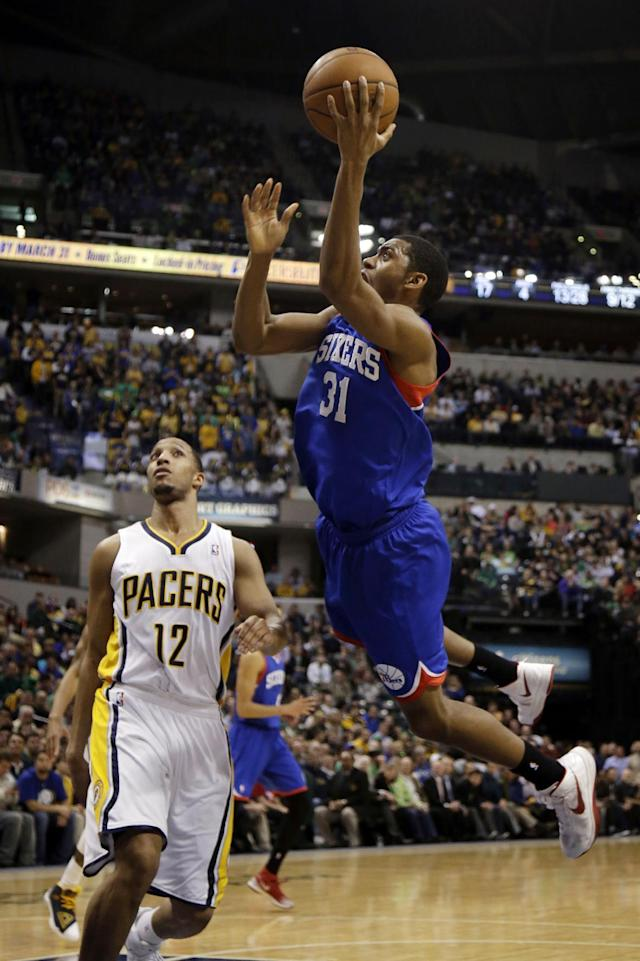 Philadelphia 76ers guard Hollis Thompson (31) shoots in front of Indiana Pacers forward Evan Turner (12) during the first half of an NBA basketball game in Indianapolis, Monday, March 17, 2014. (AP Photo/AJ Mast)