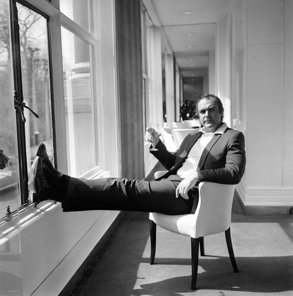"FILE - In this file photo dated April 11, 1971, renowned British actor Sean Connery, famous for his role as secret agent James Bond 007, relaxes at the River Room of the Savoy Hotel in London, after coming back from ""The Grave"" to take his famous Bond role in the United Artists film version of the James Bond story ""Diamonds Are Forever"". Connery, 40, later left for Las Vegas where filming for the picture is in progress. Scottish actor Sean Connery, considered by many to have been the best James Bond, has died aged 90, according to an announcement from his family. (AP Photo/Bob Dear, FILE)"