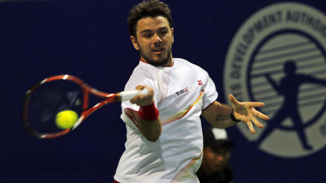 Stanislas Wawrinka of Switzerland plays a shot against Benjamin Becker of Germany during the second round of the ATP Chennai Open 2014 in Chennai, India, Wednesday, Jan. 1, 2014. Wawrinka won the match. (AP Photo/Arun Sankar K.)