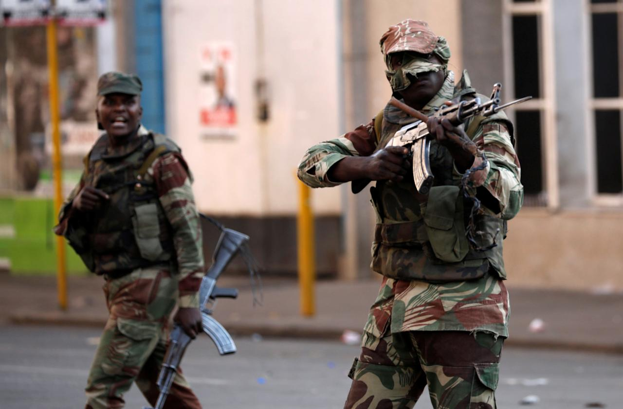 <p>Soldiers open fire to disperse crowds of the opposition Movement for Democratic Change supporters outside the party's headquarters in Harare, Zimbabwe, August 1, 2018. (Photo: Mike Hutchings/Reuters) </p>