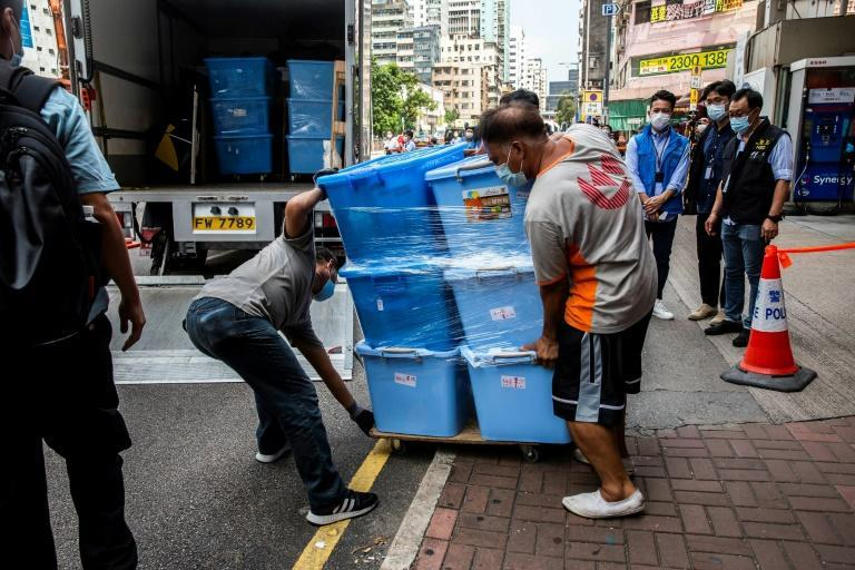 Police carted away dozens of boxes of items from the June 4 museum (AFP/ISAAC LAWRENCE)