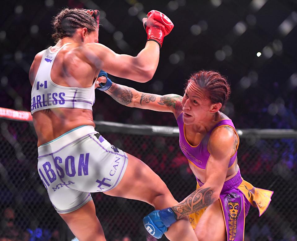 INGLEWOOD, CA - JANUARY 25: Julia Budd (red gloves) and Cris Cyborg (blue gloves) exchange blows during their featherweight world title fight at The Forum on January 25, 2020 in Inglewood, California. Cyborg won by TKO in the 4th round. (Photo by Jayne Kamin-Oncea/Getty Images)