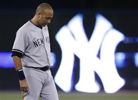 New York Yankees' Derek Jeter reacts after the end of the first inning against the Toronto Blue Jays in their MLB American League baseball game in Toronto August 28, 2013. REUTERS/Mark Blinch