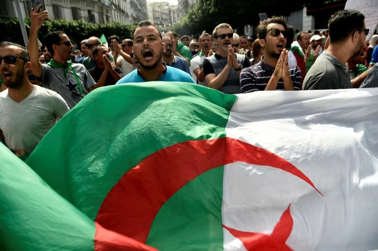 Algerian protesters have been demanding sweeping reforms including the departure of powerful army chief Ahmed Gaid Salah (AFP Photo/RYAD KRAMDI                        )