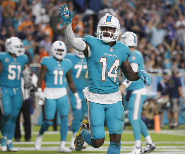 FILE - In this Sunday, Nov. 5, 2017 file photo, Miami Dolphins wide receiver Jarvis Landry (14) waves to fans after scoring a touchdown, during the second half of an NFL football game against the Oakland Raiders in Miami Gardens, Fla. The Miami Dolphins decided receiver Jarvis Landry is worth any headaches he causes, even if the cost is $16 million. Landry was given a non-exclusive franchise tag Tuesday, Feb. 20, 2018 after leading the NFL with 112 catches in 2017. The move by the Dolphins came on the first day that teams could assign franchise tags.(AP Photo/Wilfredo Lee, File)
