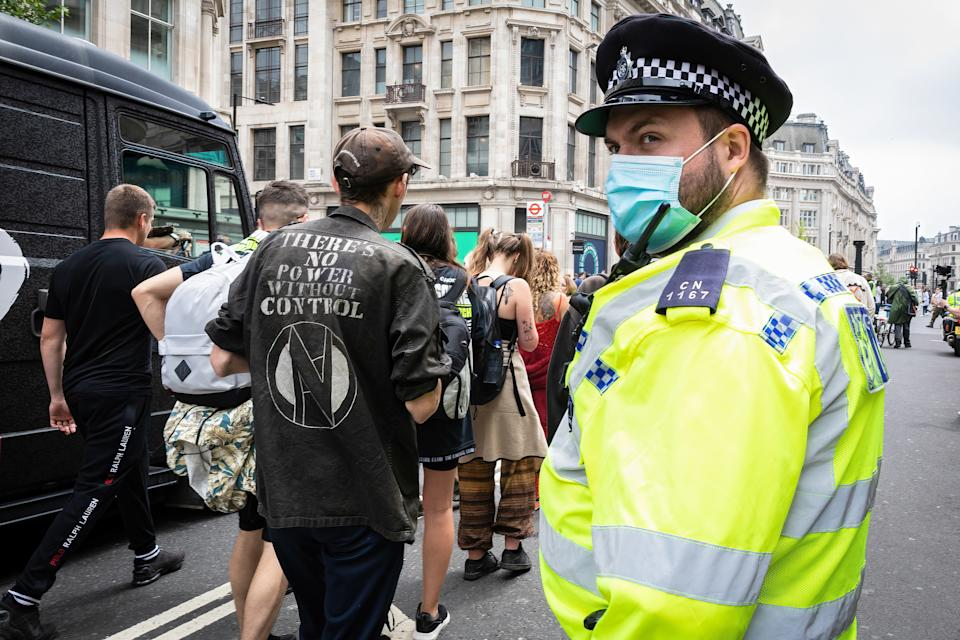 A police officer monitors a march in the UK. Source: Sipa/AAP