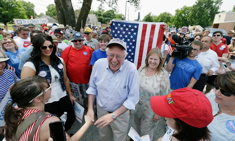 Sen. Bernie Sanders greets local residents before walking in a Fourth of July parade on Saturday, July 4, 2015, in Waukee, Iowa.