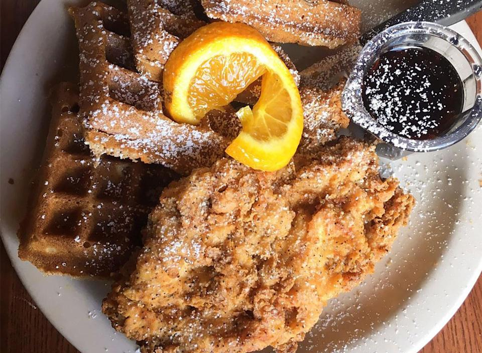 plate of chicken and waffles with syrup