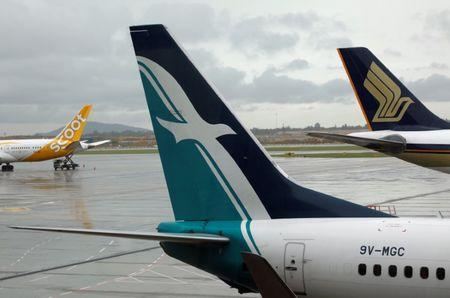 FILE PHOTO: SilkAir, Singapore Airlines and Scoot planes sit on the tarmac at Changi Airport in Singapore