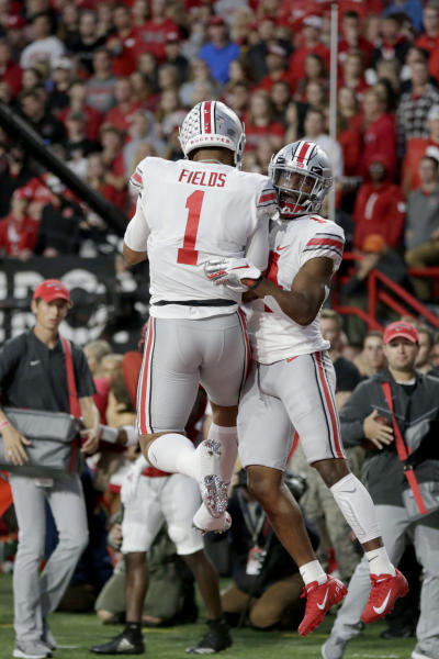 Ohio State wide receiver K.J. Hill, right, celebrates his touchdown with quarterback Justin Fields (1) during the first half of an NCAA college football game against Nebraska in Lincoln, Neb., Saturday, Sept. 28, 2019. (AP Photo/Nati Harnik)