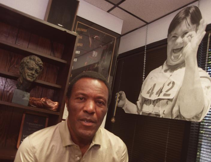Rafer Johnson works as a volunteer for the Special Olympics in his office in Culver City.