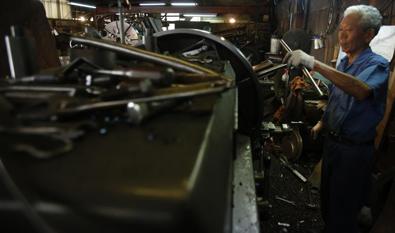 A man works inside a factory in Tokyo