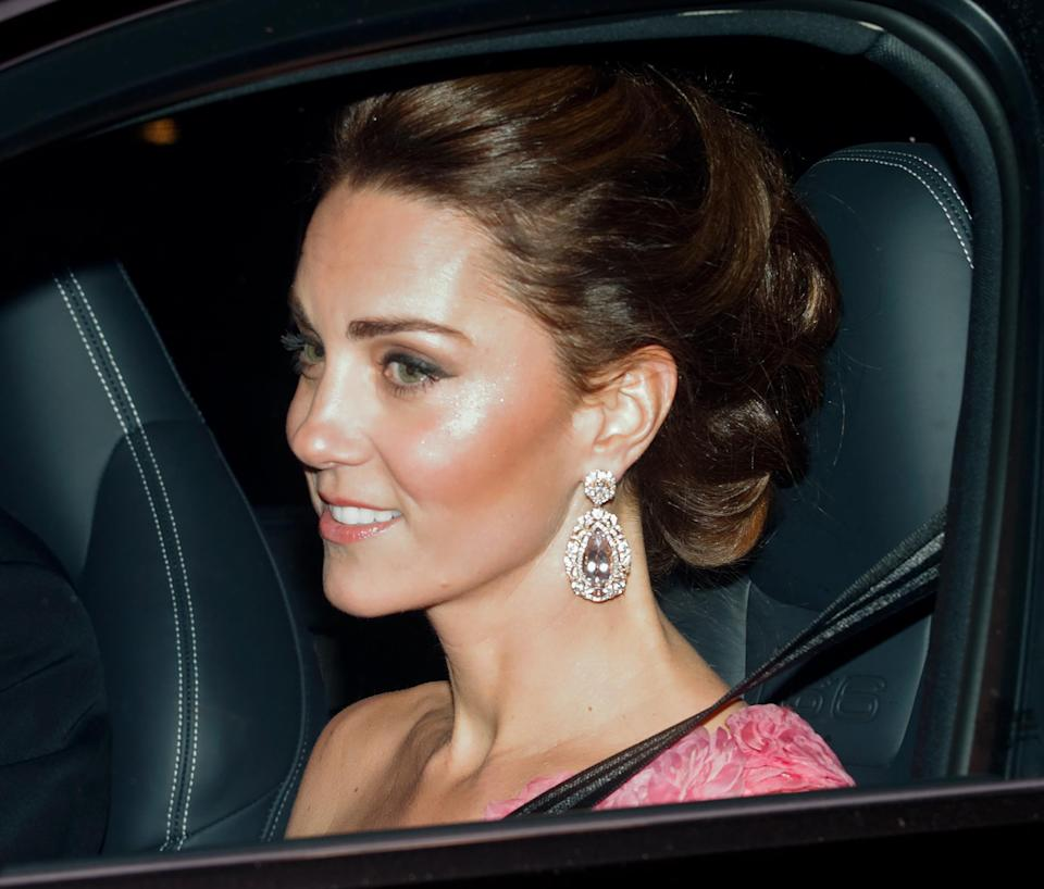 The Duchess of Cambridge arrived at the regal event wearing some seriously sparkly earrings and covetable highlighter [Photo: Getty]
