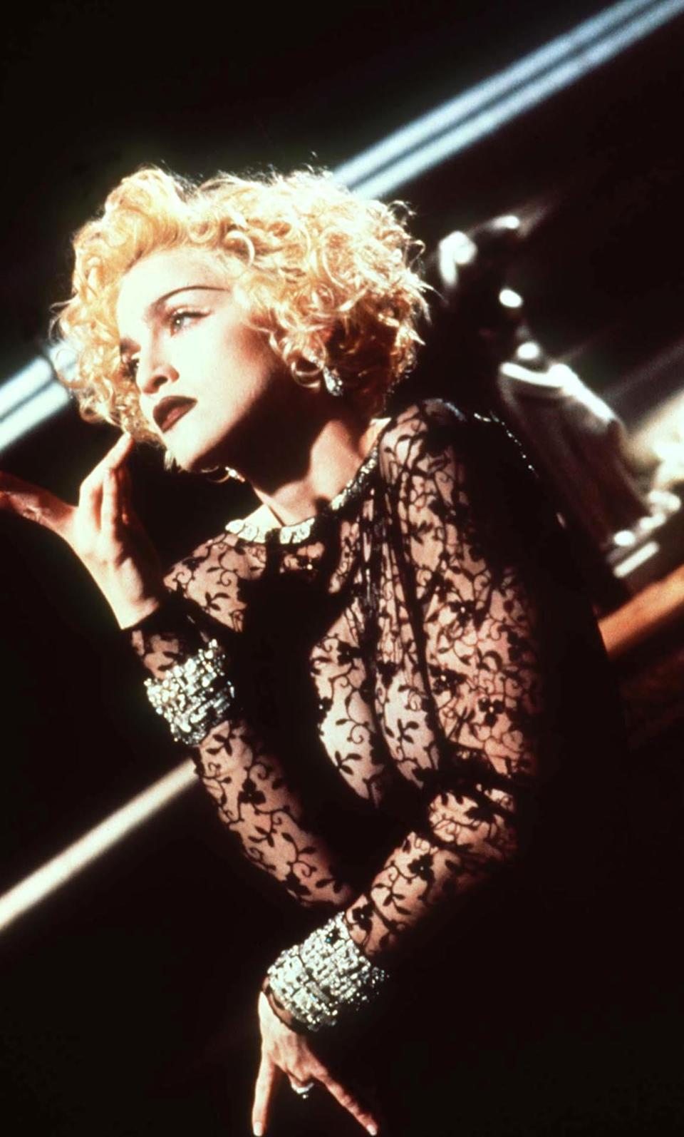 <p>Madonna on the set of her 'Vogue' musical video in 1990</p>Rex/Shutterstock