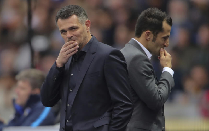 Bayern's interim coach Willy Sagnol, left, and sports director Hasan Salihamidzic pictured during the German Bundesliga soccer match between Hertha BSC Berlin and Bayern Munich at the Olympic Stadium in Berlin, Germany, Sunday, Oct. 1, 2017. (Michael Kappeler/dpa via AP)