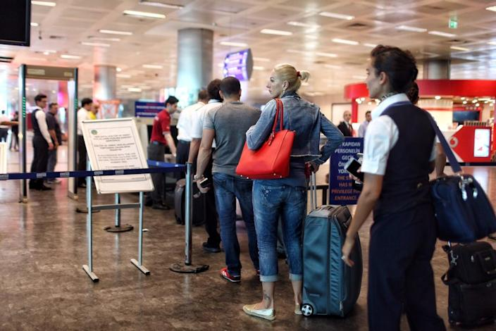 <p>Passengers wait in line in front of an x-ray machine at a security check point at Turkey's largest airport, Istanbul Ataturk, following yesterday's blasts June 29, 2016, Turkey. (Defne Karadeniz/Getty Images) </p>