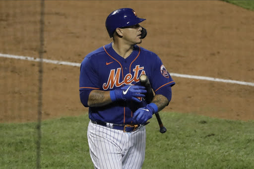 New York Mets' Wilson Ramos reacts after striking out during the ninth inning of a baseball game against the Washington Nationals Tuesday, Aug. 11, 2020, in New York. The Nationals won 2-1. (AP Photo/Frank Franklin II)