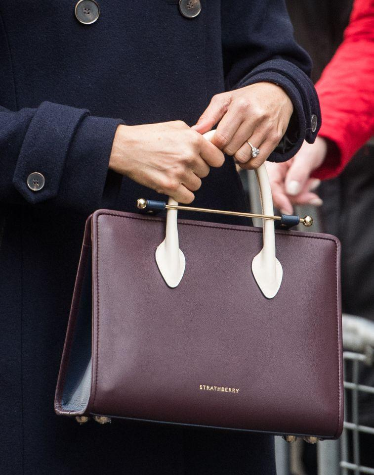 <p>The tri-tone leather tote is from Edinburgh-based brand Strathberry – but only available from Sak's in NYC. The store sent Markle the bag a few weeks ago. According to The Telegraph, the bag sold out within minutes of Markle wearing it. (Photo: Getty) </p>