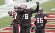 Tampa Bay Buccaneers running back Ronald Jones (27) celebrates his score against the Atlanta Falcons during the second half of an NFL football game Sunday, Jan. 3, 2021, in Tampa, Fla. (AP Photo/Mark LoMoglio)