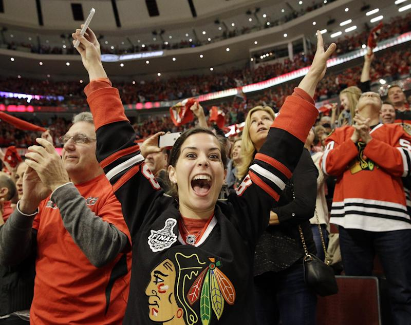 Jenna Miglio celebrates after Chicago Blackhawks' Bryan Bickell 929) scored his goal against the Minnesota Wild during the second period  in Game 5 of an NHL hockey second-round playoff series in Chicago,Sunday, May 11, 2014