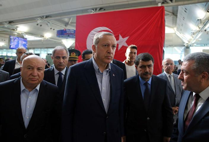 <p>Turkey's President Recep Tayyip Erdogan, center, visits Ataturk Airport in Istanbul, after Tuesday's blasts, Saturday July 2, 2016. (Kayhan Ozer, Presidential Press Service, Pool via AP) </p>