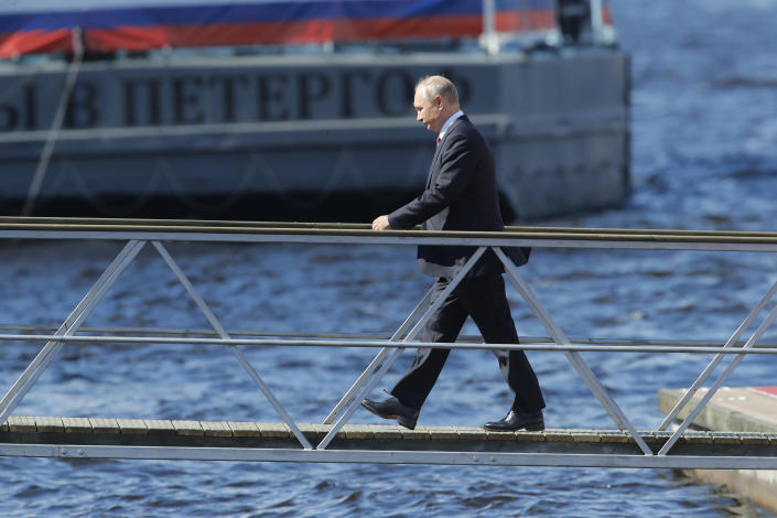 Russian President Vladimir Putin arrives to attend the military parade during the Navy Day celebration in St.Petersburg, Russia, Sunday, July 26, 2020.(AP Photo/Dmitri Lovetsky, Pool)