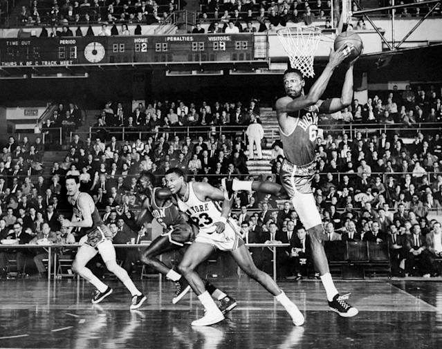 Bill Russell grabs a rebound. He was really, really good at that. (Charles Payne/NY Daily News Archive via Getty Images)