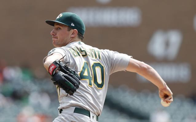 Oakland Athletics starting pitcher Chris Bassitt throws during the first inning of a baseball game against the Detroit Tigers, Thursday, May 16, 2019, in Detroit. (AP Photo/Carlos Osorio)