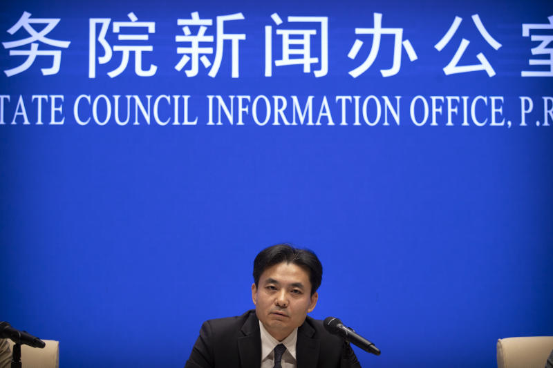 "Yang Guang, spokesman for the Chinese Cabinet's Hong Kong and Macao Affairs Office, speaks during a press conference in Beijing, Tuesday, Aug. 6, 2019. A Chinese official responsible for Hong Kong affairs says punishment for those behind weeks of sometimes violent protests in the Chinese special administrative region is ""only a matter of time."" (AP Photo/Mark Schiefelbein)"