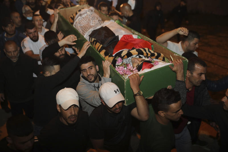 Muslim men carry the body of Iyad Halak to burial after Israeli police shot him dead in Jerusalem's old city, Sunday, May 31, 2020. Israel's defense minister has apologized for the Israeli police's deadly shooting of an unarmed Palestinian man who was autistic. (AP Photo/Mahmoud Illean)