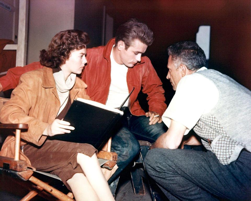 <p>James Dean wears his character's infamous red jacket while reviewing a scene with costar, Natalie Wood, and the director, Nicholas Ray. It was one of Dean's biggest roles during his short career.</p>