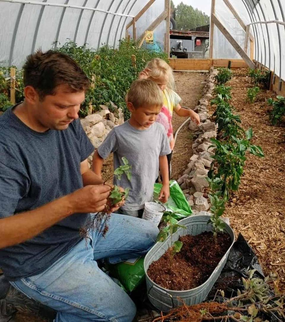 Chris Rogers gardening with Colt and Calena. PA REAL LIFE