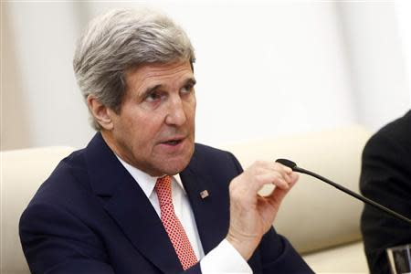 John Kerry gestures as he speaks to Wang Yi during their meeting at the Ministry of Foreign Affairs in Beijing