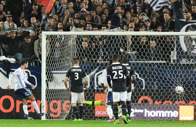 Lyon's Emanuel Mammana (L) scores a late goal  during their match against Bordeaux on March 3, 2017