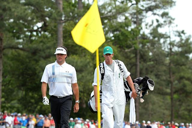 AUGUSTA, GA - APRIL 13: Bubba Watson of the United States and his caddie Ted Scott walks onto the eighth green during the final round of the 2014 Masters Tournament at Augusta National Golf Club on April 13, 2014 in Augusta, Georgia. (Photo by Andrew Redington/Getty Images)