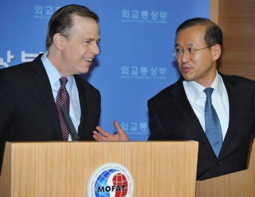 This file photo shows Glyn Davies (L), coordinator for US policy on North Korea, listening to South Korea's nuclear envoy Lim Sung-Nam during a press conference in Seoul, on February. Davies, Lim and Japan's counterpart Shinsuke Sugiyama have begun fresh talks on N.Korea and other issues amid concerns the communist state may be planning another nuclear test, according to Seoul's foreign ministry