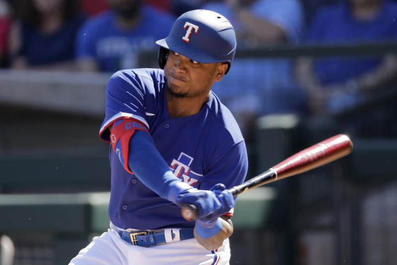 Texas Rangers' Willie Calhoun bats during the first inning of a spring training baseball game against the Chicago White Sox Saturday, Feb. 29, 2020, in Surprise, Ariz. (AP Photo/Charlie Riedel)
