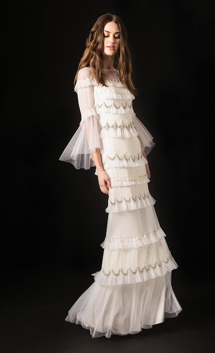 <p>The embelished tiers on this Temperley London column dress take a simple shape to the next level.</p>