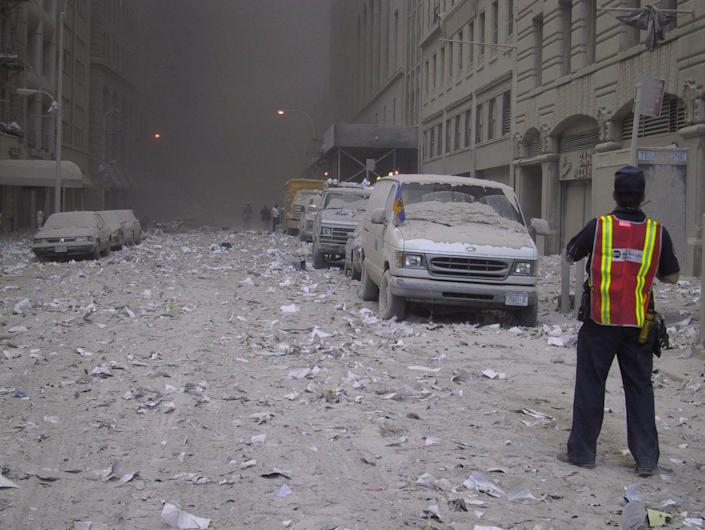 <p>Ash covers a street in downtown New York City after the collapse of the World Trade Center on Sept. 11, 2001. (Photo: Bernadette Tuazon/AP) </p>
