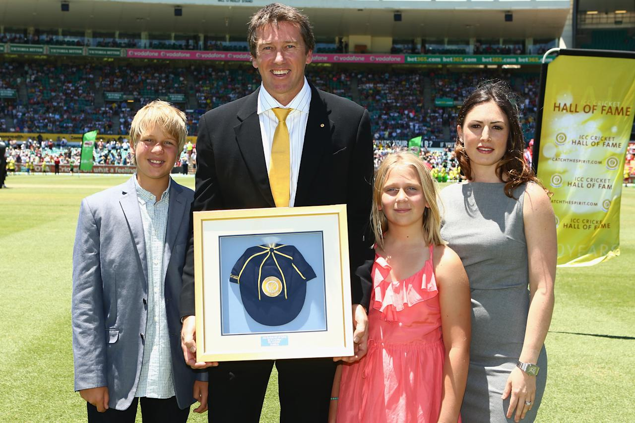 SYDNEY, AUSTRALIA - JANUARY 04:  Former Australian cricketer Glenn McGrath holds his commemorative cap in recognition of his ICC Hall of Fame Induction as he poses with his son James, daughter Holly and wife Sara Leonardi-McGrath during day two of the Third Test match between Australia and Sri Lanka at Sydney Cricket Ground on January 4, 2013 in Sydney, Australia.  (Photo by Mark Kolbe/Getty Images)