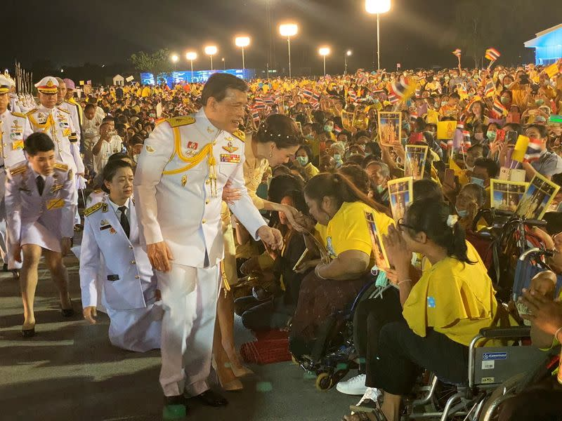 Thailand's King Maha Vajiralongkorn and Queen Suthida greet royalists at an airport in Udon Thani province