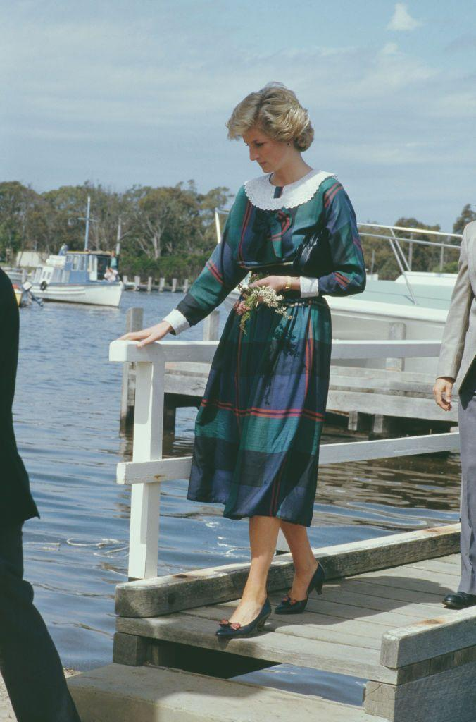 <p>Diana chose a colorful plaid frock with a white bib collar for a visit to Rotamah Island in Australia, October 1985.</p>
