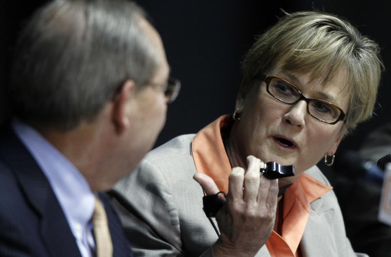New Tennessee women's college basketball coach Holly Warlick, right, shows school chancellor Jimmy Cheek the whistle given to her by former coach Pat Summitt during a news conference Thursday, April 19, 2012, in Knoxville, Tenn. Summitt, who has more wins than any other college basketball coach, announced Wednesday she is stepping down after 38 seasons. (AP Photo/Wade Payne)