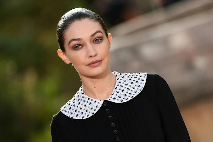 Mother superior: American model Gigi Hadid wears a nun's habit dress with a claudine collar at the Chanel haute couture show in Paris (AFP Photo/CHRISTOPHE ARCHAMBAULT )