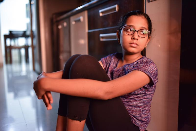 Girl sitting on kitchen floor