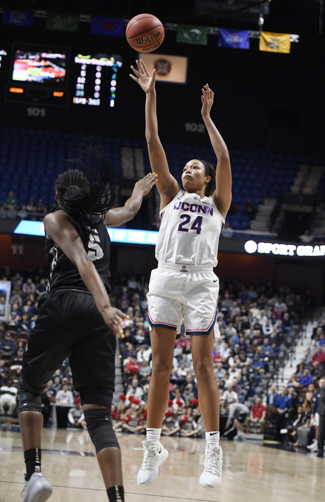 Connecticut's Napheesa Collier (24) shoots over Central Florida's Masseny Kaba (5) during the first half of an NCAA college basketball game in the American Athletic Conference women's tournament finals, Monday, March 11, 2019, at Mohegan Sun Arena in Uncasville, Conn. (AP Photo/Jessica Hill)