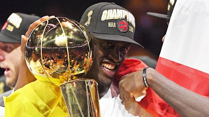 Pascal Siakam of the Toronto Raptors, pictured holding the Larry O'Brien championship trophy after defeating the Golden State Warriors.