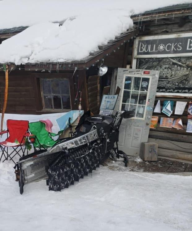 A snowmobile crashed into the porch of Bullocks just after lunch hour Thursday. (Submitted by Jo-Ann Martin - image credit)